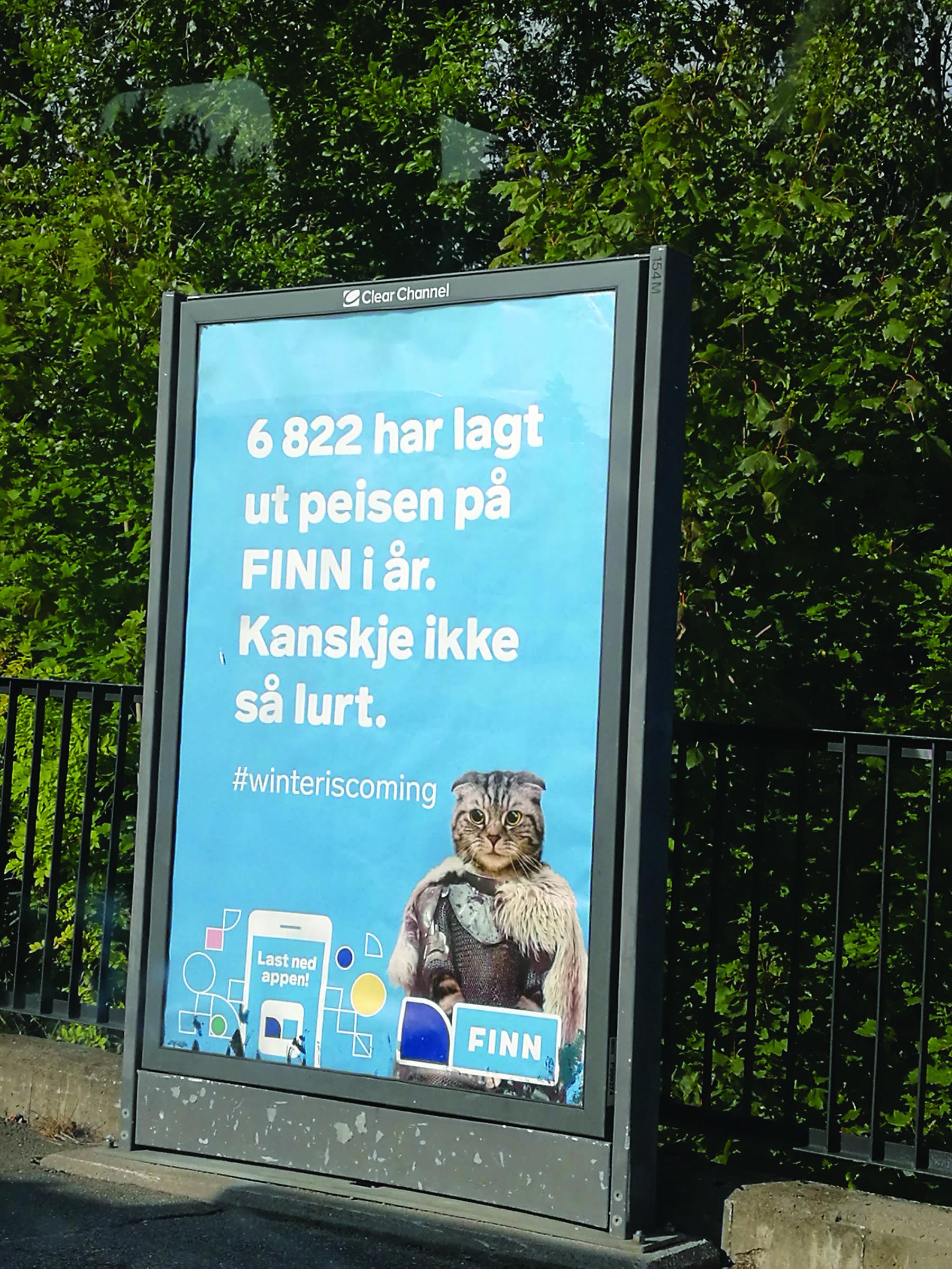 """Reklame med maskotten til Finn.no """"Pusefinn"""" om salg av varer"""